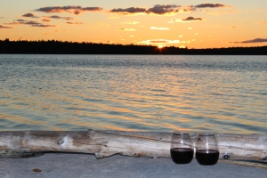 A glass of boxed wine on the rock beach.